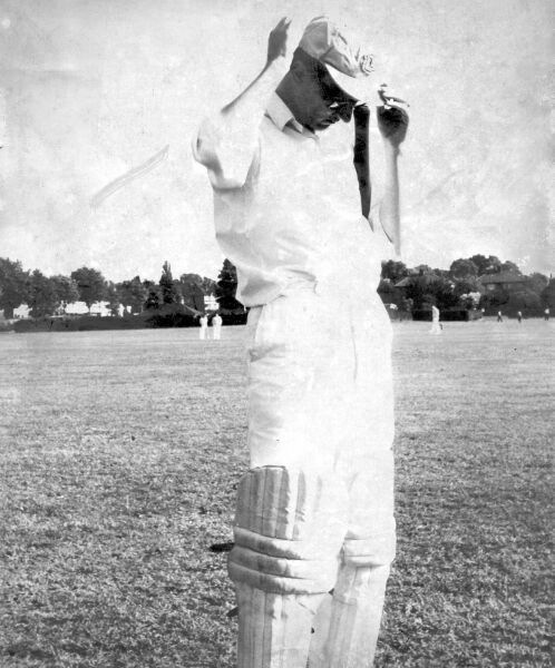 Dave Tickner adjusts his cap before going out to bat at Rose Hill, some time around 1970